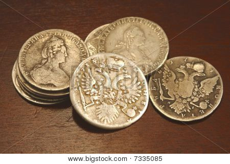ancient russian coins  old silver tzar rubles on the table poster