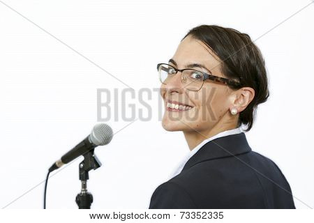 Sucssesful businesswomen keynote speaker in front of microphone before public speaking poster