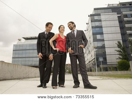 Multi-ethnic businesspeople standing outdoors