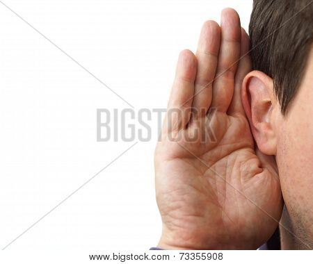 Businessman Holds His Hand Near His Ear And Listening