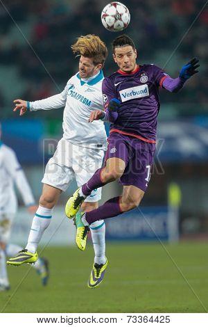 VIENNA, AUSTRIA - DEZEMBER 11 Cristian Ansaldi (#3 Zenit) and Philipp Hosiner (#16 Austria) fight for the ball at a UEFA Champions League game on Dezember 11, 2013 in Vienna, Austria.