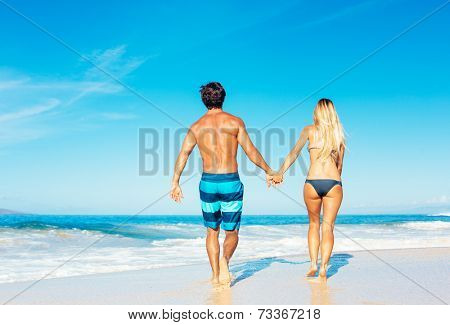Happy Attractive Couple Walking on Beautiful Sunny Beach