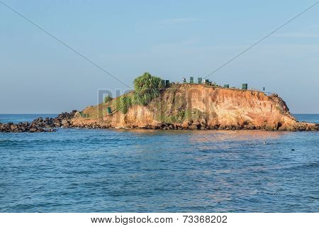 Big rock with viewpoint on both sides of Weligama bay in Sri Lanka.