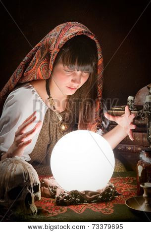 Fortune-teller using a crystal ball to predict the future