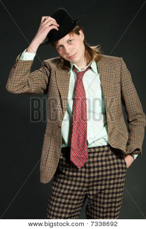 Young man is in a suit