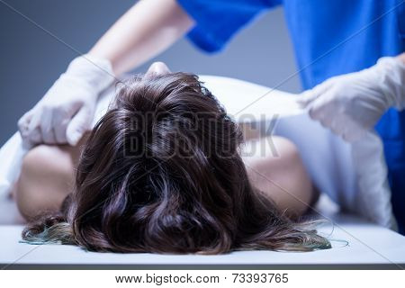 Nurse Covering The Dead Body