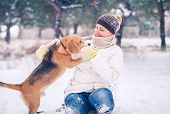 Woman with her pet has winter active leisure time poster