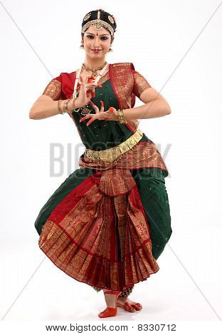 Lady performing bharatanatyam indian dance with rich religious dress poster