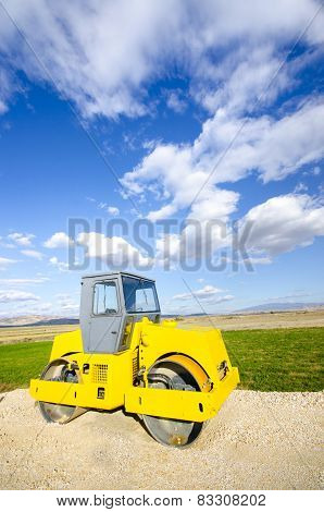 Yellow Steamroller on construction site