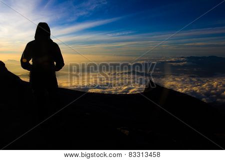 Female Hiker On Top Of Mountain For Sunrise Or Sunset
