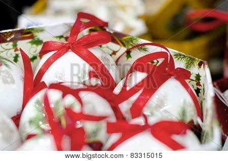 White Collection Of Christmas Balls With Red Ribons