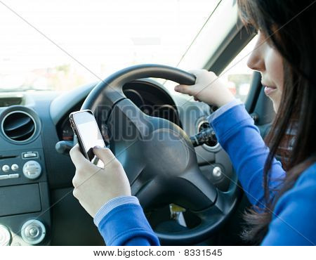 Beautiful Brunette Woman Using Her Cellphone While Driving