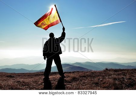 Man waving Spanish flag