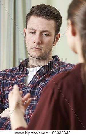 Depressed Young Man Talking To Counsellor
