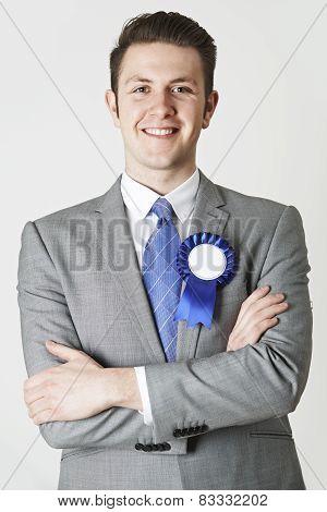Portrait Of Politician Wearing Blue Rosette