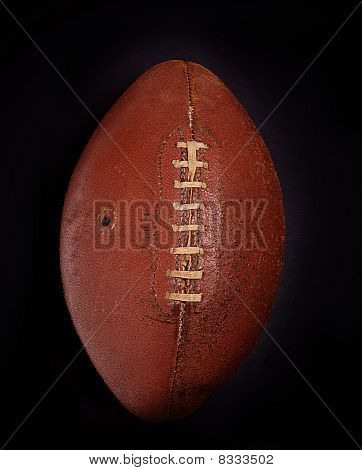 Antique retro football isolated against black background poster