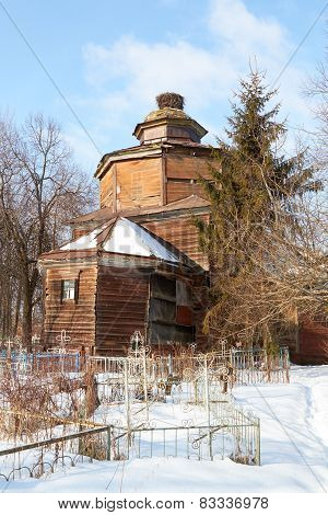 destroyed old Wooden  church on orthodox cemetery in winter, Russia