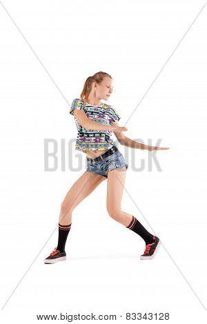 Beautiful booty dancer posing on studio background