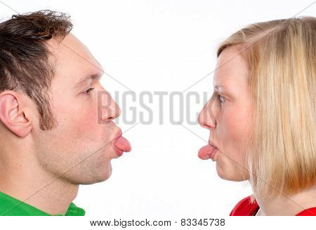 Couple Heaving Fun And Poke The Tongue Out