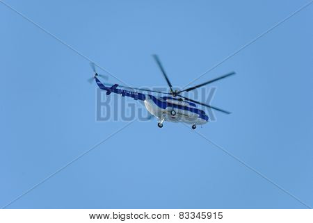 NIZHNY NOVGOROD. RUSSIA. FEBRUARY 17, 2015. The Mi-8 helicopter flies against the blue sky.