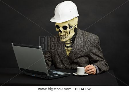 Comical Man In Helmet And Skeleton Mask With Computer