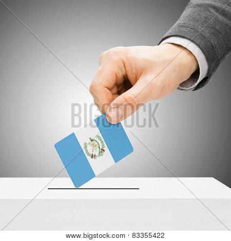 Voting Concept - Male Inserting Flag Into Ballot Box - Guatemala