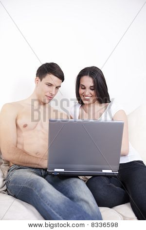 Young sexy couople with laptop