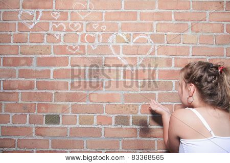 A child with brink wall as a background