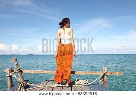 Sexy Woman on the bridge above sea