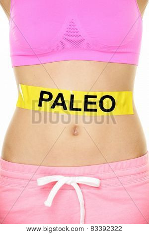 Paleo diet concept - closeup of woman's stomach to show eating concept. New trend in nutrition based on hunter gatherer consumption of proteins. Yellow label as warning or caution applied on body. poster