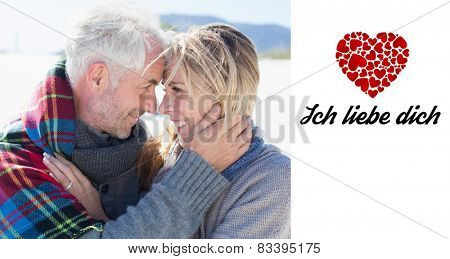 Happy married couple embracing on the beach against ich liebe dich poster