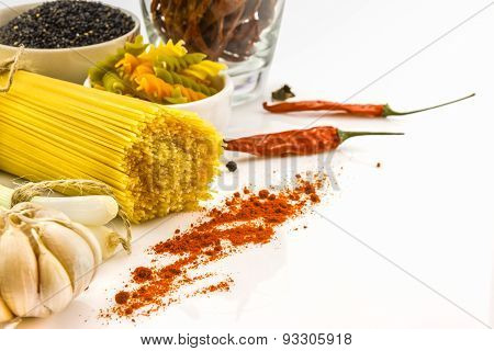 The herv, spice and pasta on white background.