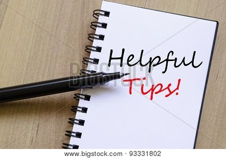 White notepad and ink pen on the wooden desk Helpful tips concept poster