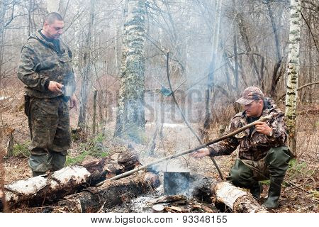 Two Hunters Over The Campfire