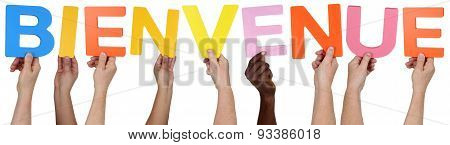 Multi Ethnic Group Of People Holding The French Word Bienvenue Welcome