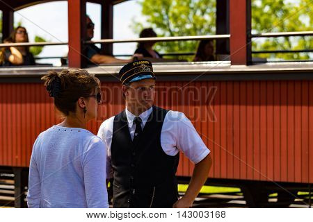 Strasburg PA - July 19 2016: A train conductor at the Strasburg Rail Road.