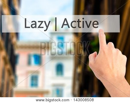Active  Lazy - Hand Pressing A Button On Blurred Background Concept On Visual Screen.