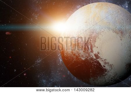 Solar System - Pluto. It is a dwarf planet in the Kuiper belt, a ring of bodies beyond Neptune. It is the largest known dwarf planet in the Solar System. Elements of this image furnished by NASA.