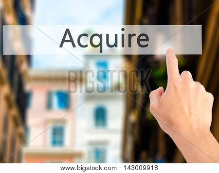 Acquire - Hand Pressing A Button On Blurred Background Concept On Visual Screen.