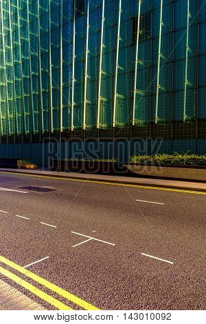 Empty street with freshly painted yellow and white lines with net type pattern on front of building. Includes copy space.