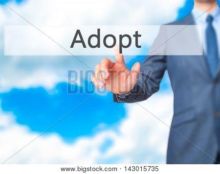Adopt -  Businessman Press On Digital Screen.