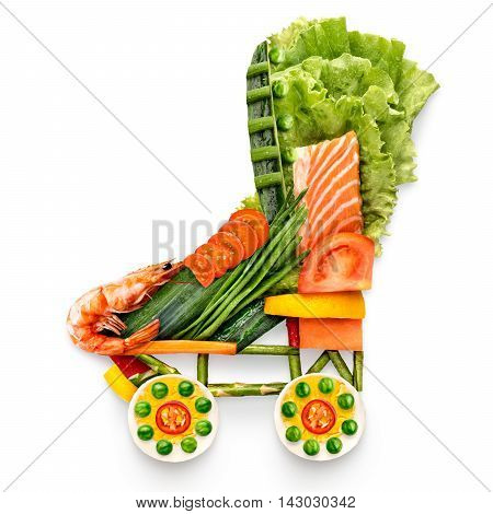 Healthy food concept of quad roller skates made of fresh vegetables and fruits full of vitamins isolated on white.