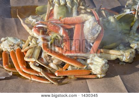 A seafood medley of steaming crab legs crayfish and vegetables poster