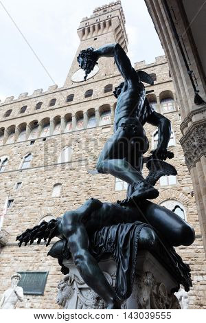 Perseus with the Head of Medusa is a bronze sculpture made by Benvenuto Cellini in 1545. from the back you can see the self-image of the sculptor Cellini on the backside of Perseus' helmet.