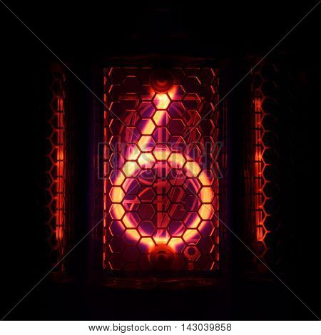 The real Nixie tube indicator of the numbers of retro style. Indicator glow with a magical purple fringing. Digit 6
