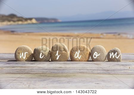 Wisdom writing on the stone at beach