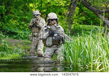 Green Berets US Army Special Forces Group soldiers in action