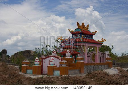 Vietnamese tomb in the cemetery surrounded by hill of clay. Typical vietnamese tomb - vault. Hue Central Vietnam Asia
