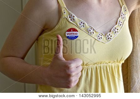 Asheville, North Carolina, USA - August 5, 2012: Close up of a female showing a thumbs up hand sign and wearing a