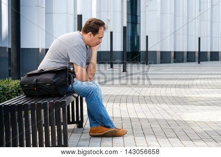Sad middle age man portrait outdoors